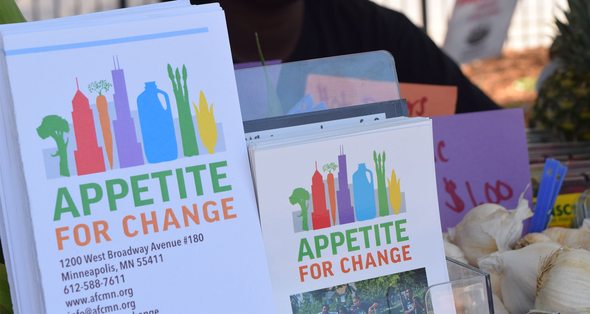 Appetite for change signs at the farmers market