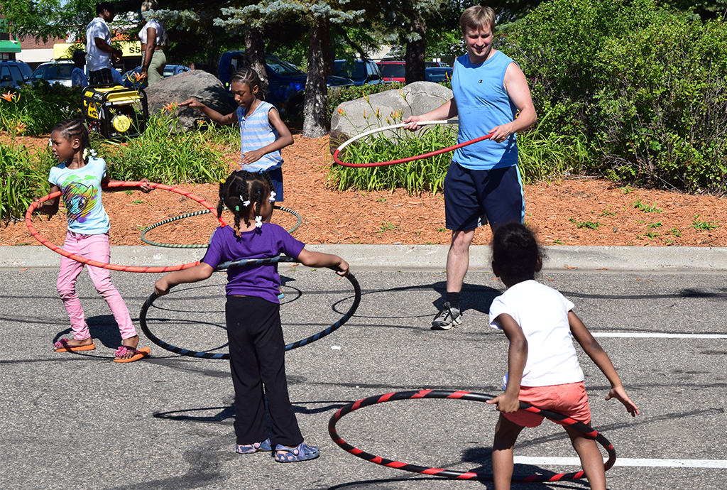 Young kids learning how to hula hoop